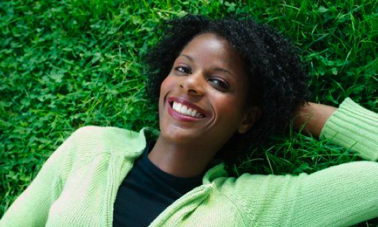 happy-black-woman-laying-in-grass1