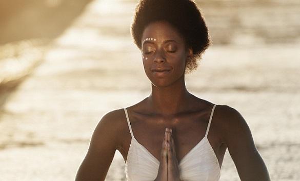 Woman meditation at sunset