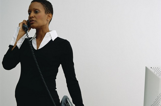 Pregnant Businesswomen Telephoning