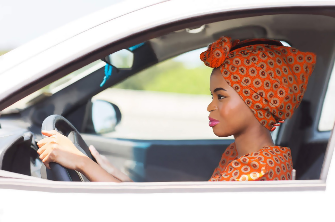 24398306-beautiful-young-african-woman-driving-a-car-Stock-Photo