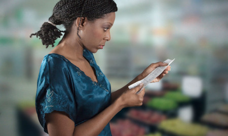 bblack-woman-looking-at-grocery-shopping-list-1