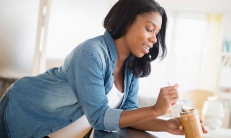 pregnant-woman-eating-peanut-butter